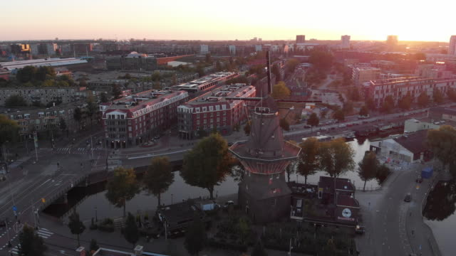 aerial view to windmill in amsterdam - alternative energy stock videos and b-roll footage