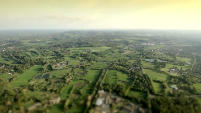 aerial view town and country in sunshine. hd - tilt shift stock videos and b-roll footage