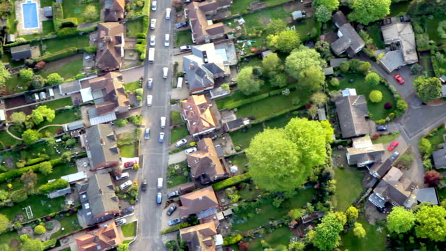 aerial view town and suburbia in sunshine. hd - suburban stock videos & royalty-free footage
