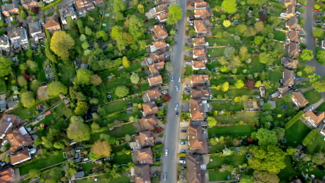 aerial view town and suburbia in sunshine. hd - suburban stock videos and b-roll footage