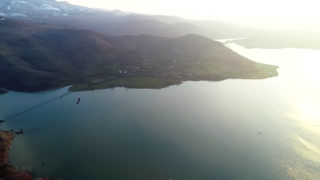 Aerial View, Tracking Shot of a Flying Vulture, Flying along Beautiful Landscape of Fjords, Mountain hills Rising Up from the Water Surface, Seascape, Sunrise-Dawn, Beauty in Nature, Travel Destinations, Adventure, Travel, Exploration, Sun