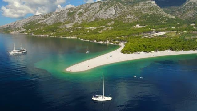 aerial view tranquil scenic view sailboat on sunny blue ocean,bol - zlatni rat,island of brac,croatia - croatia stock videos & royalty-free footage
