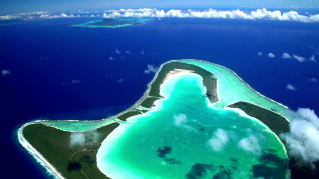 aerial view tupai heart island atoll south pacific - isola di tahaa video stock e b–roll