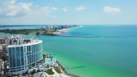 aerial view turquoise ocean & beachfront apartments - bay of water stock videos & royalty-free footage