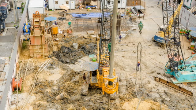 aerial view :  two crane truck under shadow in morning - construction vehicle stock videos & royalty-free footage