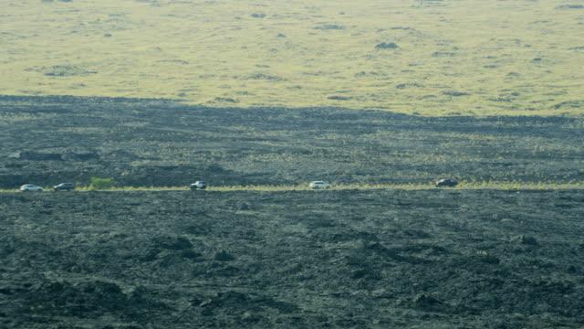 aerial view vehicle road lava rock mauna loa - mauna loa stock videos and b-roll footage