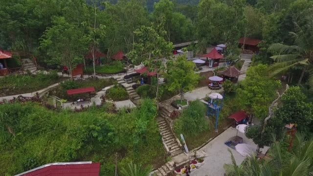 Aerial view visitors pose for photographs on a platform at the Pule Payung Tourism Hill attraction seen in this aerial video taken above Kulon Progo...