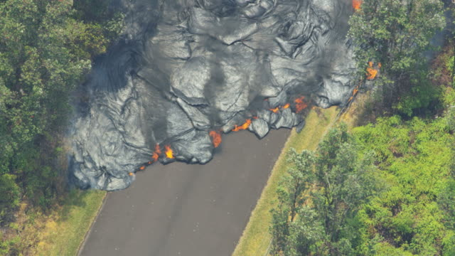 aerial view volcanic lava cooling destroying roads property - eruzione video stock e b–roll