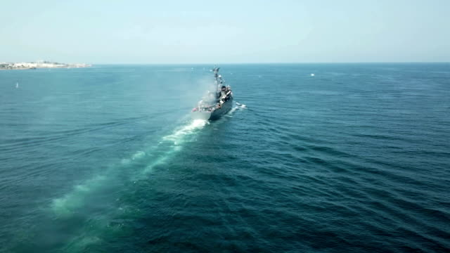 aerial view - warship on the high seas - military ship stock videos & royalty-free footage