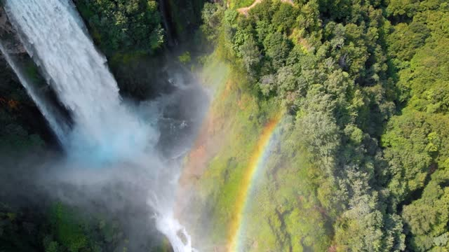 aerial view. water discharge, strong, maximum flow. rainbow. the cascata delle marmore is a the largest man-made waterfall. terni in umbria italy. hydroelectric power plant - rock stock videos & royalty-free footage