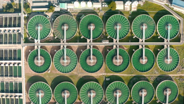 aerial view water treatment plant for environment conservation. - ecosystem stock videos & royalty-free footage