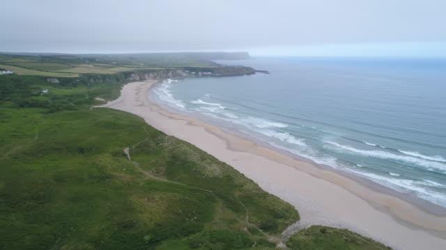 aerial view white park bay, antrim coastline, ireland - bay of water stock videos & royalty-free footage