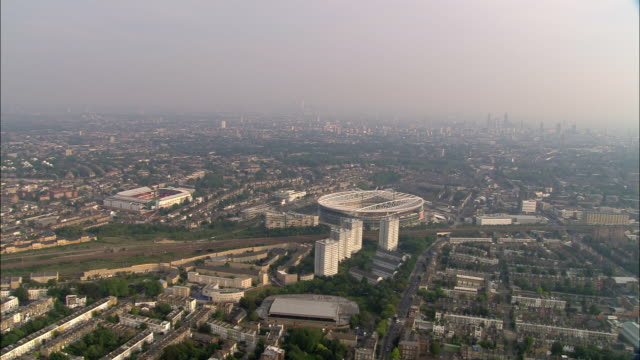 aerial view wide shot arsenal footbal stadium and surrounding area / highbury, london - surrounding stock videos and b-roll footage
