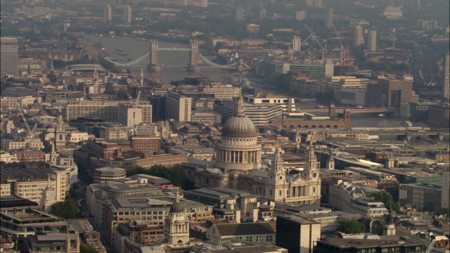 aerial view wide shot london cityscape with st. paul's cathedral in foregrand and tower bridge in background - river thames stock videos & royalty-free footage