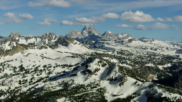 aerial view wilderness snow yellowstone national park usa - mt moran stock videos & royalty-free footage