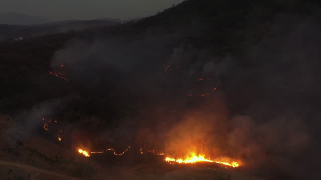 aerial view wildfire in night time - climate change stock videos & royalty-free footage
