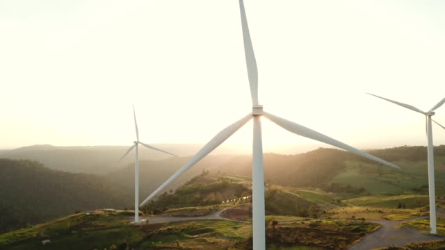 aerial view wind power in sunset - power in nature stock videos & royalty-free footage