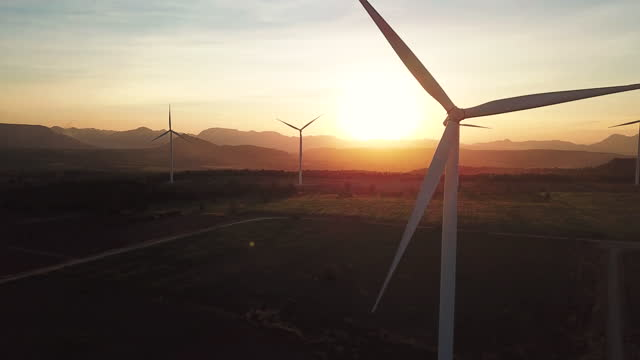 aerial view wind turbines at sunset - concept stock videos & royalty-free footage