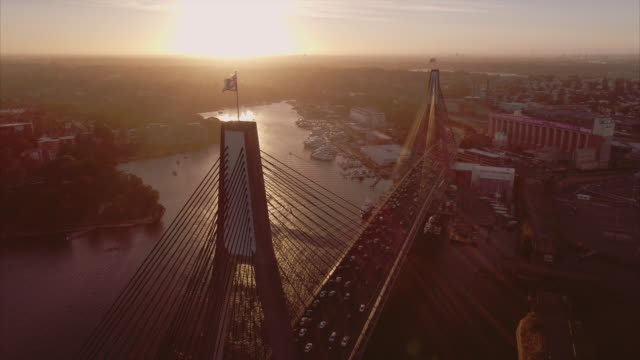 aerial view with a low pass, tilt down on the anzac bridge. sydney australia - high up stock videos & royalty-free footage