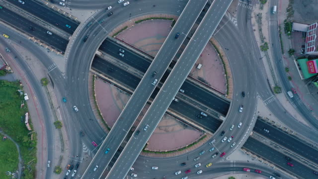 aerial view with rotate of multiple lane circle road traffic - multiple lane highway stock videos & royalty-free footage