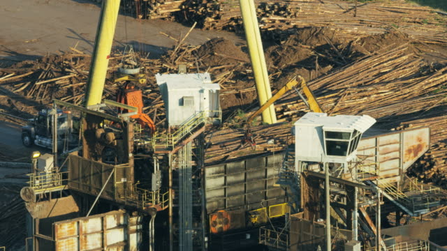 aerial view wood pulp after being processed america - construction machinery stock videos & royalty-free footage