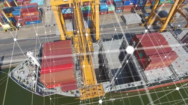 stockvideo's en b-roll-footage met luchtfoto, werk kraan en container schip in internationale vrachthaven met futuristische netwerkverbindingen - haven