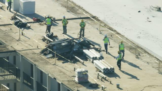 aerial view workmen repairing hurricane damaged hotel florida - 2018 stock videos & royalty-free footage