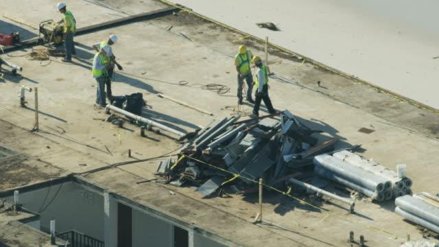 aerial view workmen repairing hurricane damaged hotel florida - damaged stock videos & royalty-free footage