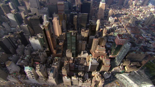 aerial view zoom out from columbus circle over upper midtown manhattan towards waldorf astoria hotel / new york, new york - waldorf astoria stock videos and b-roll footage