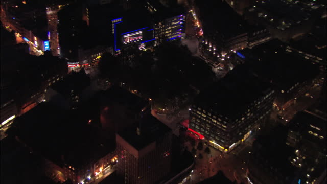 aerial view zoom out from odeon leicester square to view of west end at night / london, england - odeon kinos stock-videos und b-roll-filmmaterial