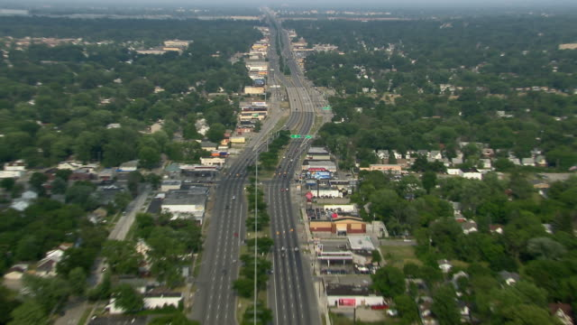 aerial view zooming in to highway sign for detroit's 8 mile road. - exit sign stock videos & royalty-free footage