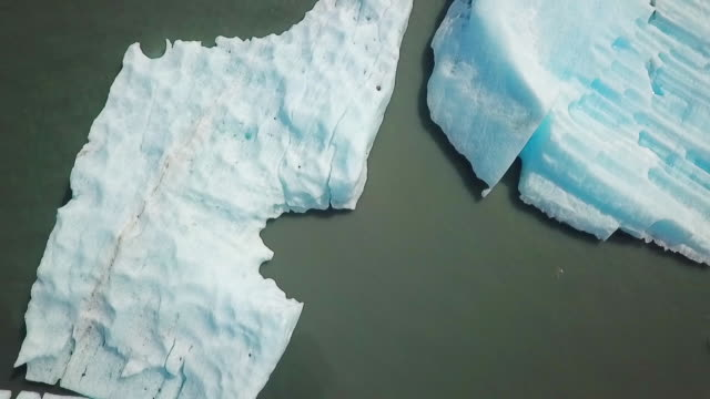Aerial View Zooming Out from Icebergs