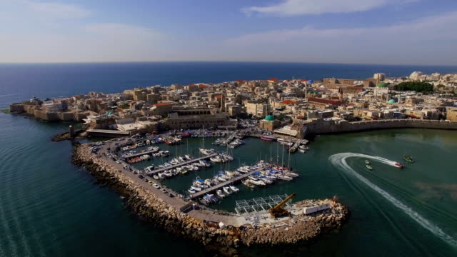aerial view-boats sailing next to the old walls  of  acre in western galilee, israel - akko stock videos and b-roll footage