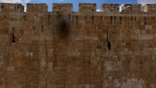 aerial view-dome of the rock reveals behind the old city walls - jerusalem old city stock videos and b-roll footage