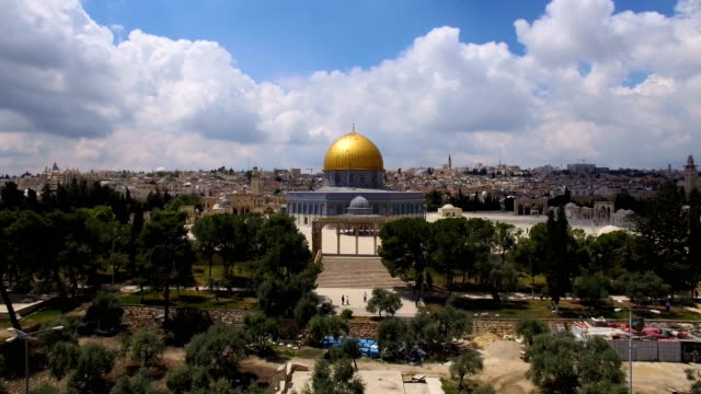 aerial view-dome of the rock reveals behind the old city walls - jerusalem stock videos & royalty-free footage