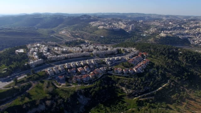aerial view/gilo -an israeli settlement and neighbourhood in south-western east jerusalem - gerusalemme est video stock e b–roll