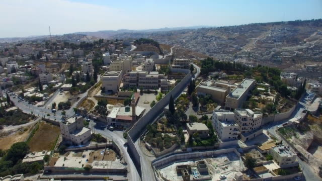 aerial view-israel defence barrier wall near gilo and beit jala, jerusalem - armistice stock videos & royalty-free footage