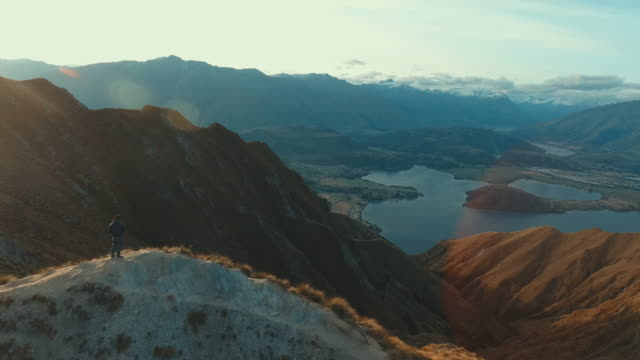 aerial view:man at top mountain - queenstown stock videos & royalty-free footage