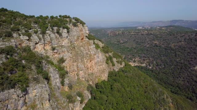 vidéos et rushes de aerial view-mountainous wadi kziv nature reserve / galilee - valley