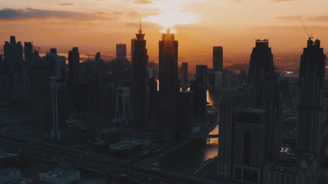 aerial views at sunrise showing various city skyscrapers, dubai, united arab emirates - morning stock videos & royalty-free footage