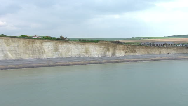 aerial views below level of cliffs along the seven sisters white cliffs swooping up and over birling gap - east sussex stock videos & royalty-free footage