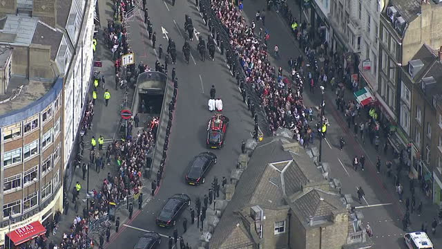 aerial views funeral cortege on procession route to southward cathedral with police officers and public lining the street on 10 april 2017 in london... - funeral procession stock videos & royalty-free footage