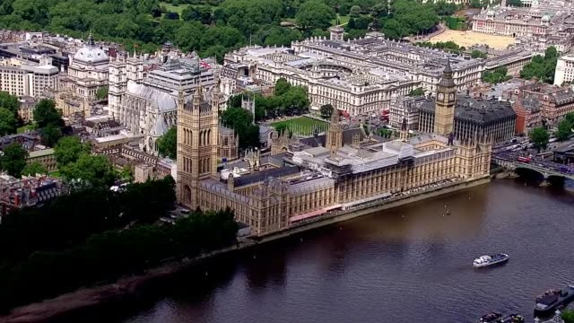 aerial views houses of parliament and buckingham palace air view london eye and houses of parliament victoria tower - victoria tower stock videos & royalty-free footage