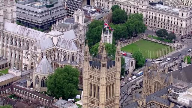 Aerial views Houses of Parliament and Buckingham Palace AIR VIEW Victoria Tower and Houses of Parliament Buckingham Palace