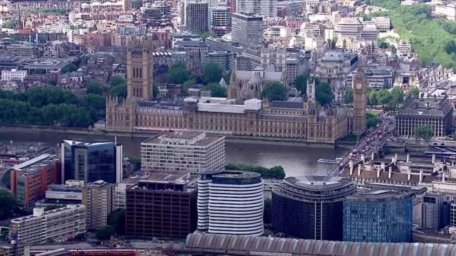Aerial views Houses of Parliament and Buckingham Palace AIR VIEW Downing Street with press waiting Houses of Parliament and Westminster Abbey London...