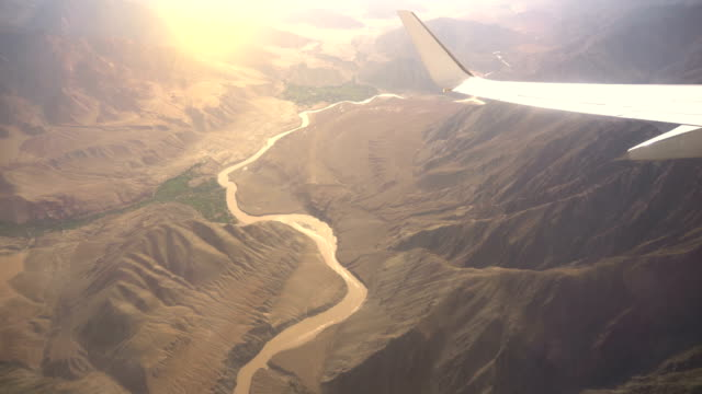 aerial views in tibet fly over to mountain himalaya - india stock videos & royalty-free footage