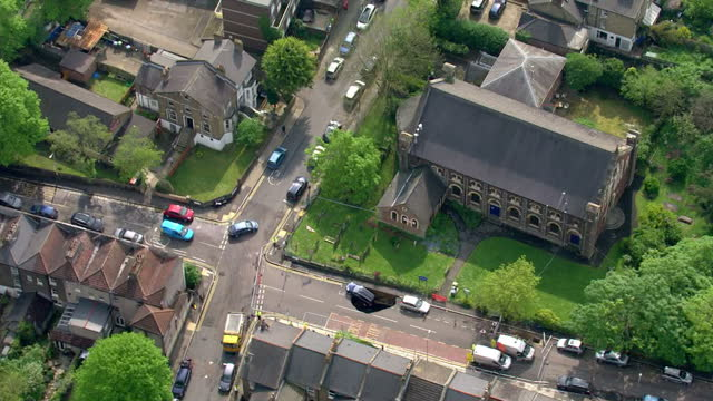 Aerial views large sinkhole in road with car half submerged on May 12 2016 in London England