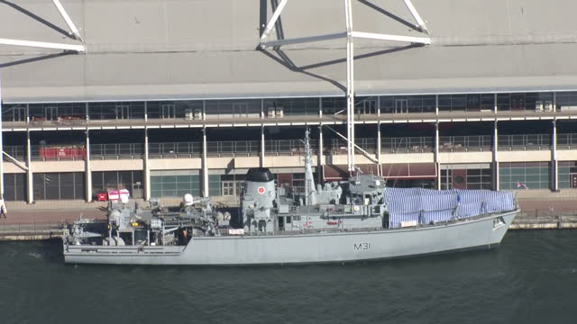 Aerial Views military gunboat on display moored alongside the Excel Centre