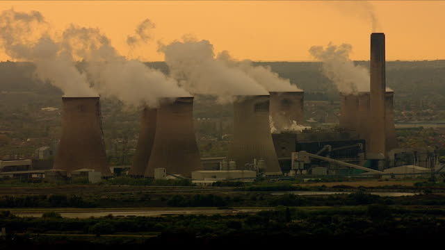 aerial views of a coal power station and pollution at sunset - environmental issues stock videos & royalty-free footage