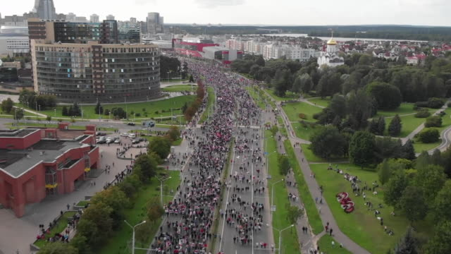 aerial views of a large anti-government protest calling for the resignation of belarus president alexander lukashenko marching through minsk - politics stock videos & royalty-free footage